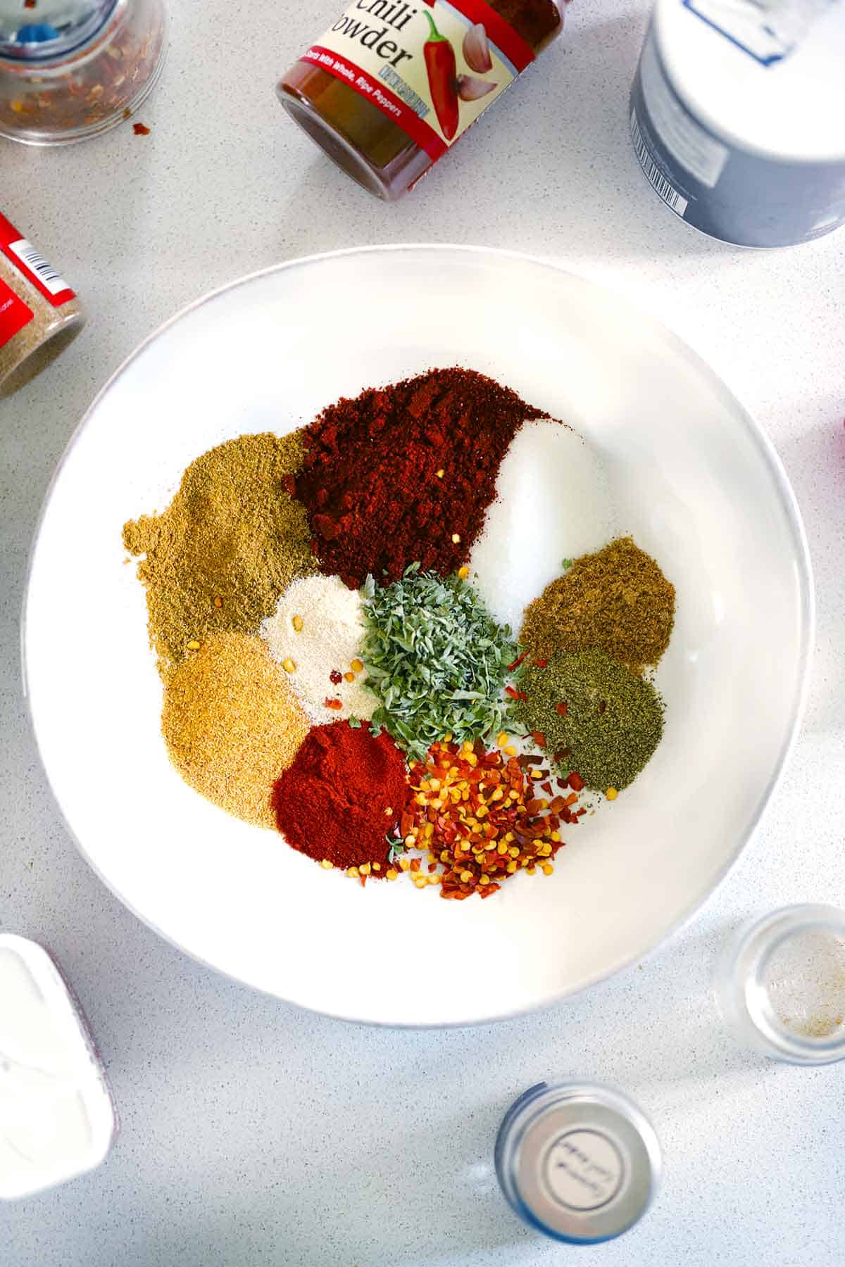 The ingredients for homemade taco seasoning in a white bowl.