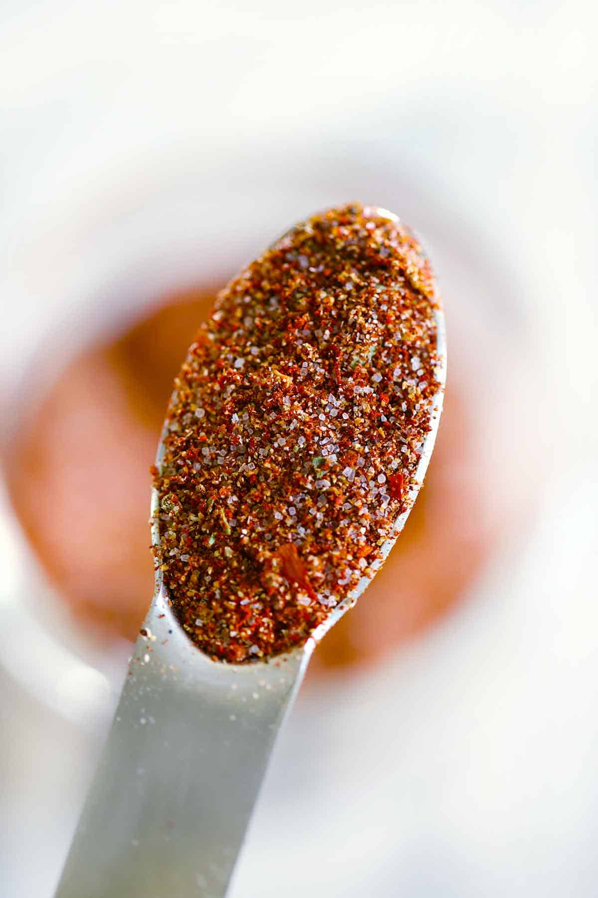 Close up photo of a spoonful of homemade taco seasoning blend.