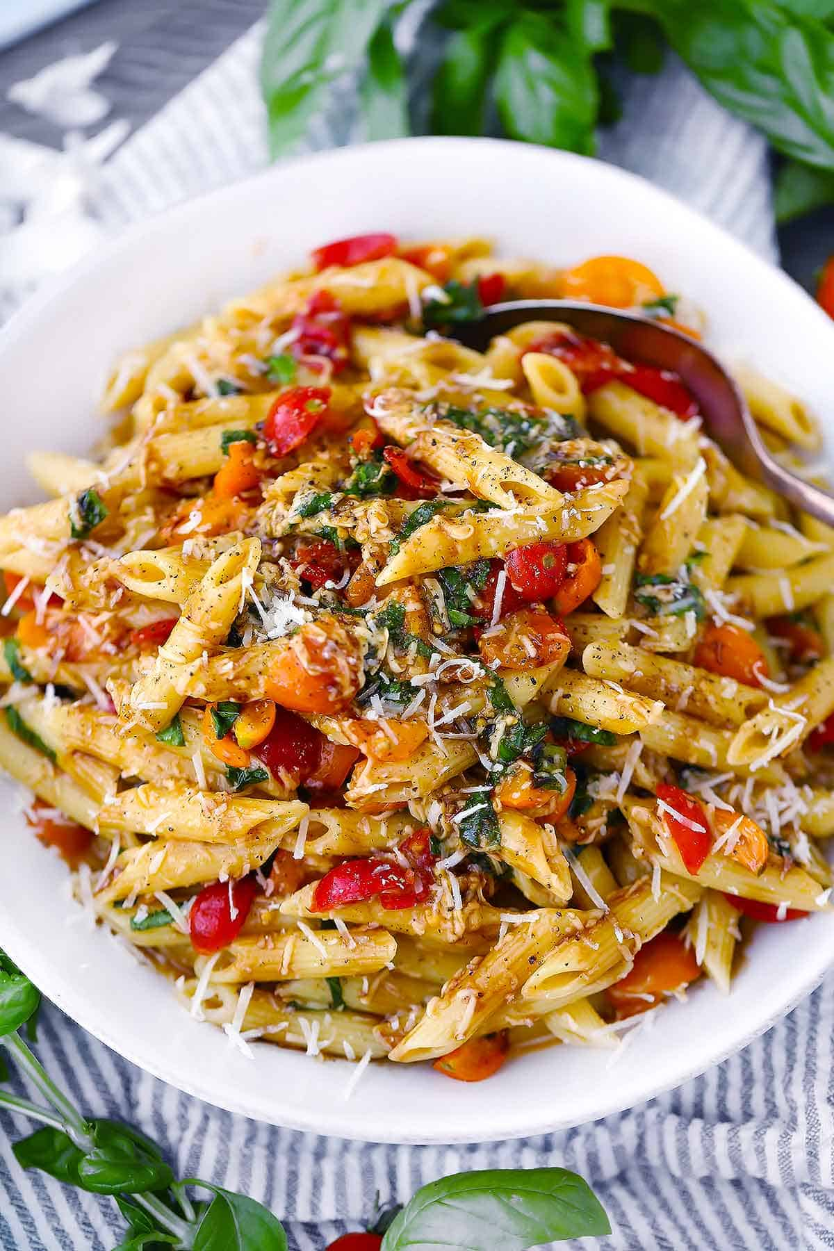 Close up photo of bruschetta pasta with tomatoes and basil.