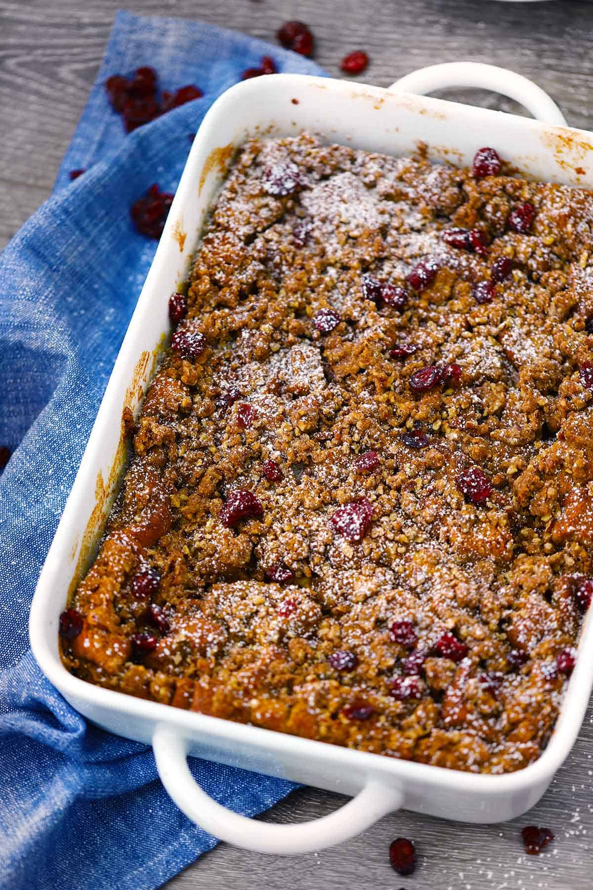 Baked pumpkin french toast casserole in a baking dish.