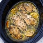 Square photo of slow cooker chicken breasts.