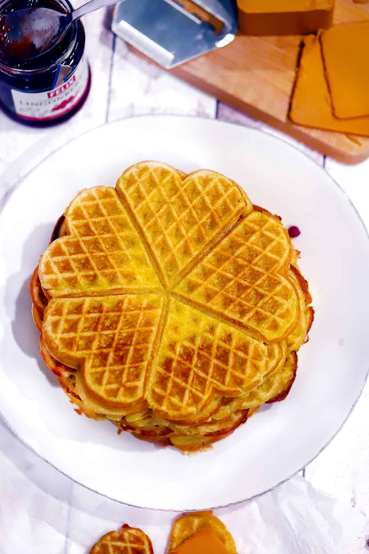 Overhead photo of a stack of heart shaped Norwegian waffles.
