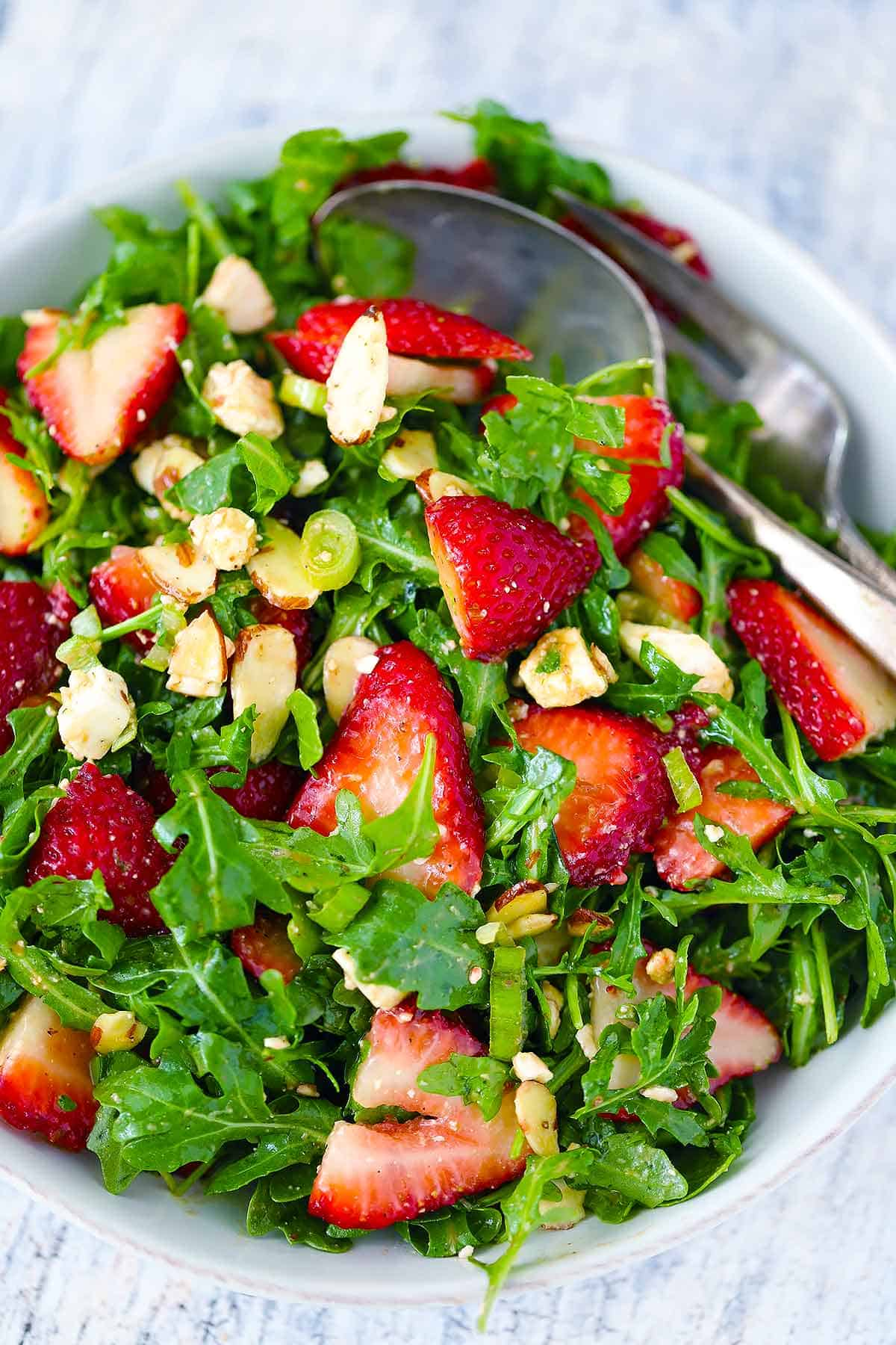 Close up photo of a strawberry arugula salad.