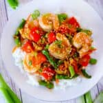 Square photo of shrimp stir fry with vegetables.
