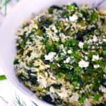 Square photo of Spanakorizo (Greek spinach and rice with lemon and dill).