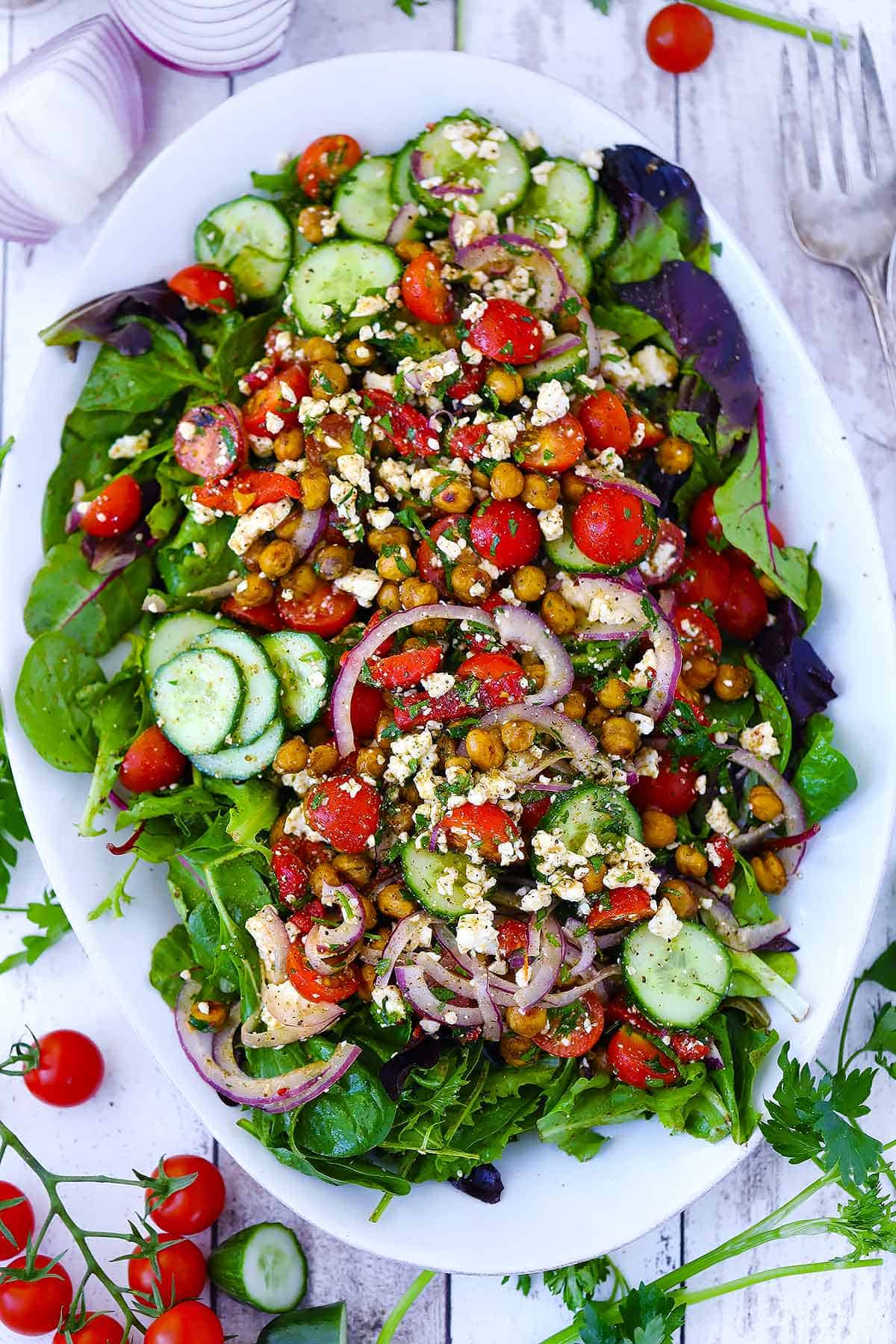 Overhead photo of a white platter with roasted chickpea salad.