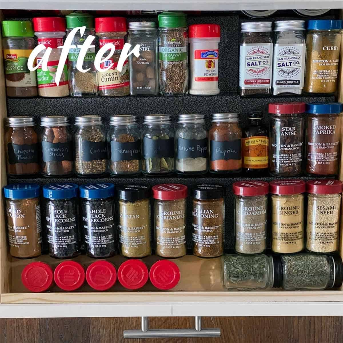 Overhead photo of spices organized on a rack in a drawer.