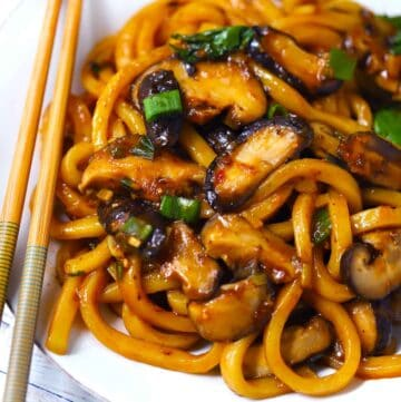 Square Photo of Udon Noodle Stir Fry with Mushrooms.